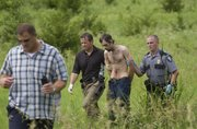 Lawrence police officers and Douglas County sheriff deputies detain a suspect in a stabbing incident along the bike path near Cli