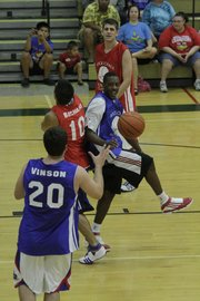 Mario Chamers, center right, passes off to Stephen Vinson during the 2010 Rock Chalk Roundball Classic at Free State High School.