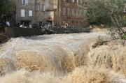 The river Artuby floods the streets in Draguignan, southern France, on Wednesday.