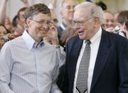 Microsoft co-founder Bill Gates, left, and billionaire investor Warren Buffett are seen during the annual Berkshire Hathaway shareholders meeting May 6, 2007, in Omaha, Neb. Gates and Buffett are launching a campaign to get other American billionaires to give at least half their wealth to charity.