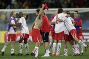 Swiss players celebrate after their 1-0 upset of Spain in their Group H World Cup match on Wednesday in Durban, South Africa.