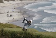 Heath Slocum hits a shot on the ninth hole during the first round of the U.S. Open golf tournament Thursday at the Pebble Beach Golf Links in Pebble Beach, Calif.
