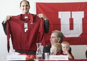 Following the University of Utah's vote to accept an invitation into the league, Pac-10 commissioner Larry Scott, left, is invited to be a Ute for a day by Utah president Michael Young, who is holding his grandchildren, Bryce and Trevor, at Rice Eccles Stadium on Thursday in Salt Lake City.