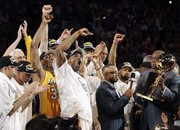 The Los Angeles Lakers celebrate winning the NBA championship, 83-79, over the Boston Celtics on Thursday in Los Angeles.