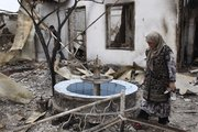 Uzbeks inspect their burned house Thursday in an Uzbek district in the southern Kyrgyz city of Osh. Some 400,000 people have been displaced by ethnic violence in southern Kyrgyzstan, the United Nations announced Thursday, dramatically increasing the official estimate of a refugee crisis that has left throngs of desperate, fearful people without enough food and water in grim camps along the Uzbekistan border.