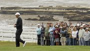 Tiger Woods, left, walks along the fourth hole during the second round of the U.S. Open on Friday at Pebble Beach, Calif.