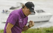 Phil Mickelson reacts after making a birdie on the fourth hole on Friday during the second round of the U.S. Open in Pebble Beach, Calif.