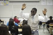 Algebra teacher LaMar Queen wears his rap glasses as he sings along with his Algebra students May 26 at the Los Angeles Academy in Los Angeles. The Los Angeles Unified School District teacher has won two awards for his innovative teaching method, by creating rap songs out of math concepts.