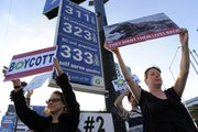 Elaine Jesmer, left, and Heather Crosson, both of Los Angeles, hold signs during a protest against BP PLC organized by Moveon.org June 8 outside an ARCO gas station in Los Angeles. ARCO is a subsidiary of British Petroleum.