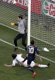 Landon Donovan (10) of the United States scores a goal against Slovenia. The Americans tied Slovenia, 2-2, on Friday at the World Cup in Johannesburg.