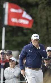 Phil Mickelson reacts to a shot on the 12th hole of the third round of the U.S. Open on Saturday in Pebble Beach, Calif.