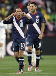 United States forward Landon Donovan, left, celebrates with teammate Clint Dempsey after scoring a goal during a World Cup soccer match against Slovenia last Friday. The U.S. will play its final group game Wednesday against Algeria.