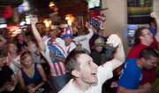 Jonathan Roper, Lawrence, pumps his fist after Landon Donovan's goal in the 92nd minute against Algeria as soccer fans watch the World Cup on Wednesday at the Red Lyon Tavern.