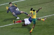 South Africa's Siphiwe Tshabalala, front, misses a chance to score against France's William Gallas, center, and France goalkeeper Hugo Lloris. South Africa held on, however, and beat France, 2-1, on Tuesday in Bloemfontein, South Africa.