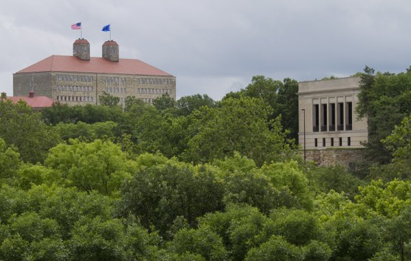 The Kenneth Spencer Research Library, right, sits quietly among the trees as compared with Fraser Hall, which dominates the campus skyline.