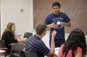 Dhaval Mysore-Krishna leads a group tutoring session in Calculus II in June at Kansas University. The Academic Achievement and Success Center offers the tutoring services. The tutors are KU students who have met grade requirements and received recommendations from faculty members.