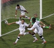 After scoring the winning goal, U.S. soccer player Landon Donovan, front left, celebrates with team members Clint Dempsey, back left, and Edson Buddle, front right. The U.S. beat Algeria, 1-0, in its World Cup Group C soccer match on Wednesday in Pretoria, South Africa, to advance to the second round.