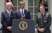 President Barack Obama, accompanied by Vice President Joe Biden and Gen. David Petraeus, announces Wednesday in the Rose Garden of the White House in Washington that Petraeus would replace Gen. Stanley McChrystal as the top commander in Afghanistan.