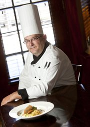Chris Wofford, executive chef of TEN restaurant at the Eldridge Hotel, 701 Mass., is shown with his Portobello Piccata.