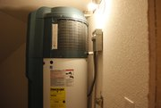 The home is equipped with a heat pump water heater, which uses the surrounding hot air to heat the water.