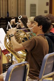 Tommy Finch, a student at Central Junior High School, plays French horn with a band in the Junior High Music Camp at the 2010 Midwestern Music Academy.