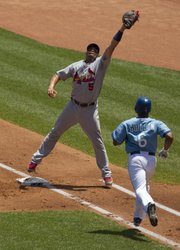 St. Louis first baseman Albert Pujols (5) leaps to make a catch forcing Kansas City's Jose Guillen out at first. The Cardinals defeated the Royals, 5-3, on Saturday in Kansas City, Mo.