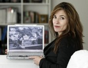 Alexandra Drane shows a picture of her sister-in-law Rosaria Vandenberg at her Winchester, Mass., home. After watching her sister-in-law lose a battle with cancer in the hospital, Drane created a website to help support people's options to spend their final days at home instead.