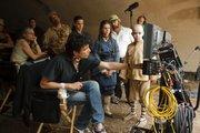 "Foreground from left: Filmmaker M. Night Shyamalan confers with Jackson Rathbone (Sokka), Nicola Peltz (Katara) and Noah Ringer (Aang) on the set of ""The Last Airbender."""