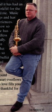 "The Rev. Dennis Carnahan, leader of BridgePointe Church, poses in a photo from the back cover of his 2002 release, ""Give Thanks."""