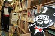 "Radio personality Barret Hansen, known on the airwaves as ""Dr. Demento,"" walks inside his record collection at his home studio in Lakewood, Calif. After nearly 40 years of broadcasting catchy little tunes celebrating everything from dogs getting run over by lawnmowers to cockroaches devouring entire cities, Dr. Demento is discontinuing his syndicated radio show but will continue broadcasting on the Web."