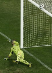 Uruguay keeper Fernando Muslera looks up to see a penalty kick by Ghana's Asamoah Gyan hit the bar during their World Cup quarterfinal. Uruguay won the 1-all draw with a 4-2 penalty-kick shootout on Friday in Johannesburg.