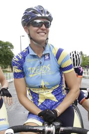 Megan Hottman, 31, of Golden, Colo., was the winner in the women's top division of the Kansas University Campus Circuit on Saturday. Heavy rain fell before the women's race, causing Hottman to crash twice.