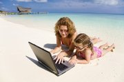 Parents and kids alike may find it hard to leave digital technology at home during vacations.