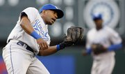 Kansas City's Alberto Callaspo looks into his glove as he holds on to a pop fly hit by Seattle's Jack Wilson in the fourth inning. The Royals beat the Mariners, 6-4 in 10 innings, Monday in Seattle.