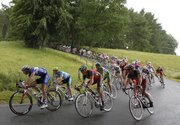 The Tour de France pack, with American Lance Armstrong, center, speeds down Aisomont hill during the second stage. Armstrong was in fifth in the overall standings after Monday's race in Spa, Belgium.
