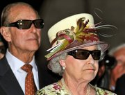 Britain's Queen Elizabeth II and Prince Philip wear 3D glasses to watch a film Monday at Pinewood Studios in Toronto. The queen and her husband are planning to visit New York today. She will address the United Nations General Assembly during her five-hour stop in the city.