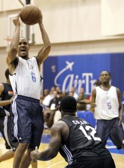 Oklahoma City's Eric Maynor (6) takes a shot over Charlotte's Sherron Collins during the second quarter of an NBA summer league game Tuesday in Orlando, Fla.