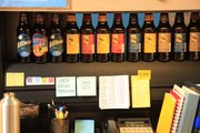 Ralston has Free State Brewing Co. beer bottles lining his desk; Callahan Creek recently worked on the bottle labels.