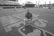Cincinnati Reds head groundskeeper Doug Gallant poses on the field with the fading sign for Mays Civil Rights baseball game held at Great American Ball Park in Cincinnati. As the Cincinnati Reds head groundskeeper, Gallant has some advice on how to improve your lawn without making it a full-time job.   