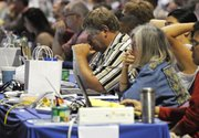 Delegates listen to the debate at a meeting of the General Assembly of the Presbyterian Church on Thursday in Minneapolis. The assembly advanced a measure lifting the church's ban on ordaining noncelibate gays and lesbians as clergy.