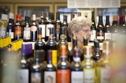 Lawrence resident Diane McFarland browses the wine selection at Myers Retail Liquor, 902 W. 23rd Street, Friday, June 9, 2010.