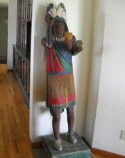 This Indian statue, which used to greet customers at George's Pipe Shop in downtown Lawrence decades ago, will be put on auction July 24, 2010 in Jefferson County.