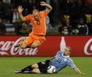 Uruguay's Diego Perez (15) competes against the Netherlands' Wesley Sneijder on Tuesday in the World Cup semifinals in Cape Town, South Africa. Perez and Uruguay will take on Germany today for third place.