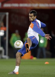Netherlands' Giovanni van Bronckhorst kicks the ball  during a training session on Saturday at Soccer City Stadium in Johannesburg. Van Bronckhorst's squad will take on Spain in the World Cup final today.