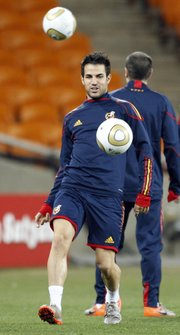 Spain's Cesc Fabregas takes part in a training session at Soccer City Stadium on Saturday in Johannesburg. The Netherlands and Spain face each other today in the World Cup final.