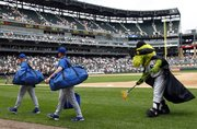 Chicago White Sox mascot Southpaw, right, uses a broom to sweep away the Royals after the White Sox claimed a 15-5 rout Sunday in Chicago.
