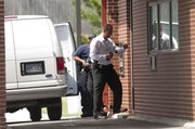 Lawrence Police investigate an armed robbery at the KU Credit Union in the 3400 block of W. Sixth Street on Monday, July 12, 2010.