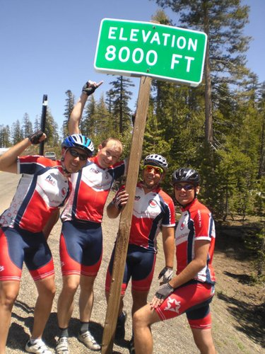 Bicyclists and Pi Kappa Phi members, from left to right, Stefan Wilkes, Jeff Serbus, Brian Wolfman and Tucker Harrison, pause at a mountain summit on an early leg of their Journey of Hope trip.