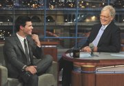 "Taylor Lautner, left, who stars in ""The Twilight Saga: Eclipse,"" joins host David Letterman on the set of the ""Late Show with David Letterman"" on June 30 in New York."