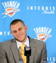 Cole Aldrich reacts with a smile as he answers questions during a news conference Monday at the Thunder practice facility in Oklahoma City.